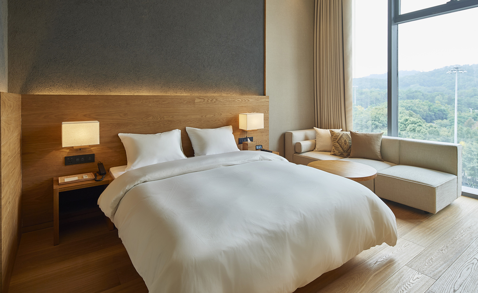 Muji brings its masterfully minimalist aesthetic to hotels for Minimalist hotel room design