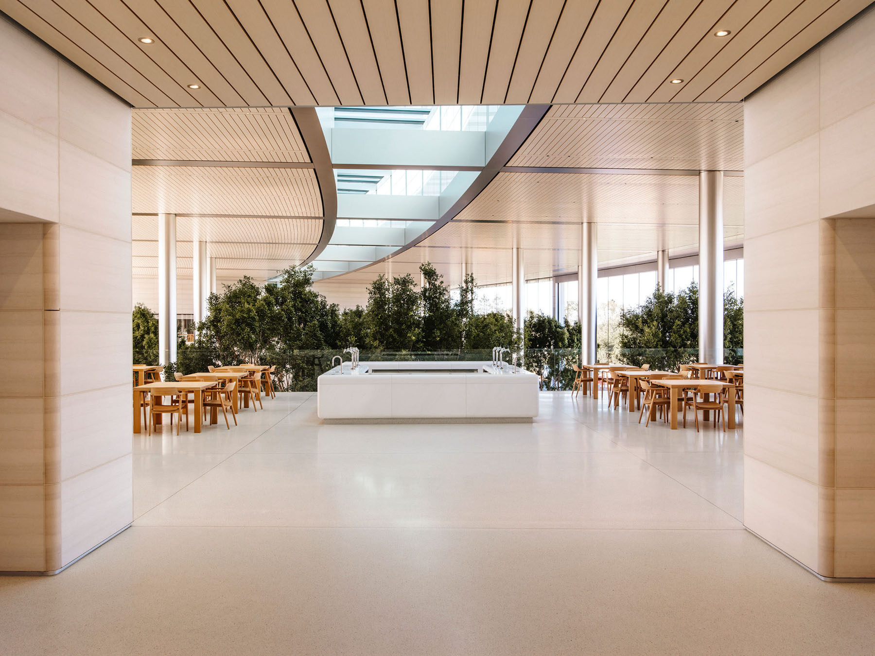 Terrace in the main café at Apple's Cupertino headquarters with Naoto Fukasawa-designed chairs and Arco benches