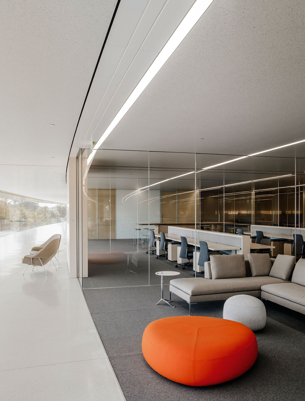 Inside Apple's Cupertino headquarters, one of the many workspace configurations and Eero Saarinen 'Womb' chairs