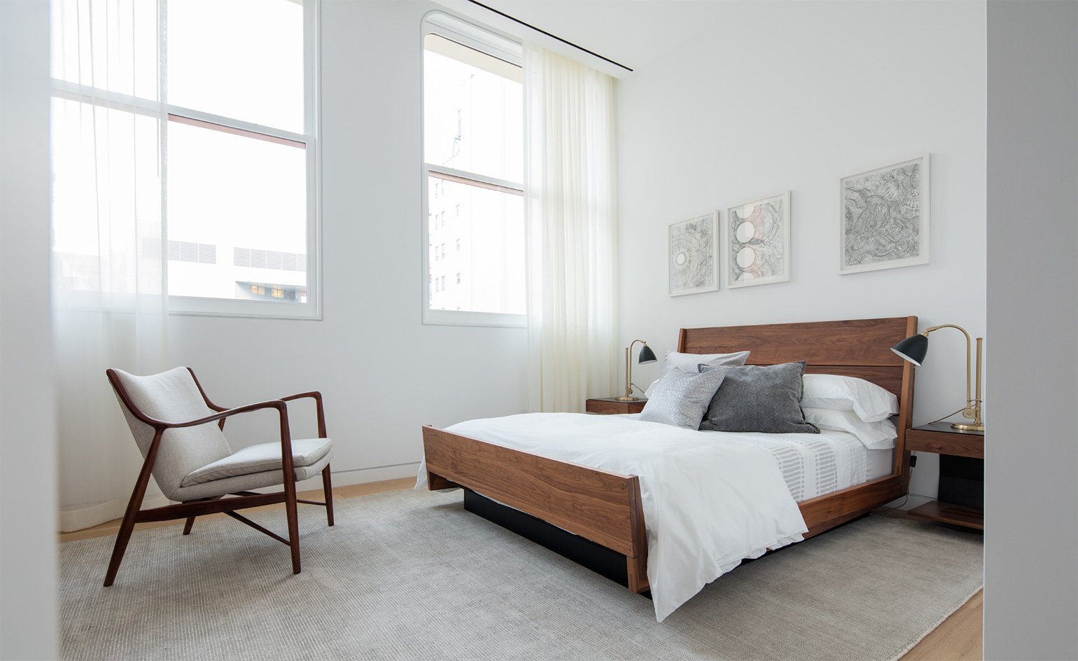 Vintage Pictured here in the second guest room a queen sized bed in walnut and a Finn Juhl Frame Chair