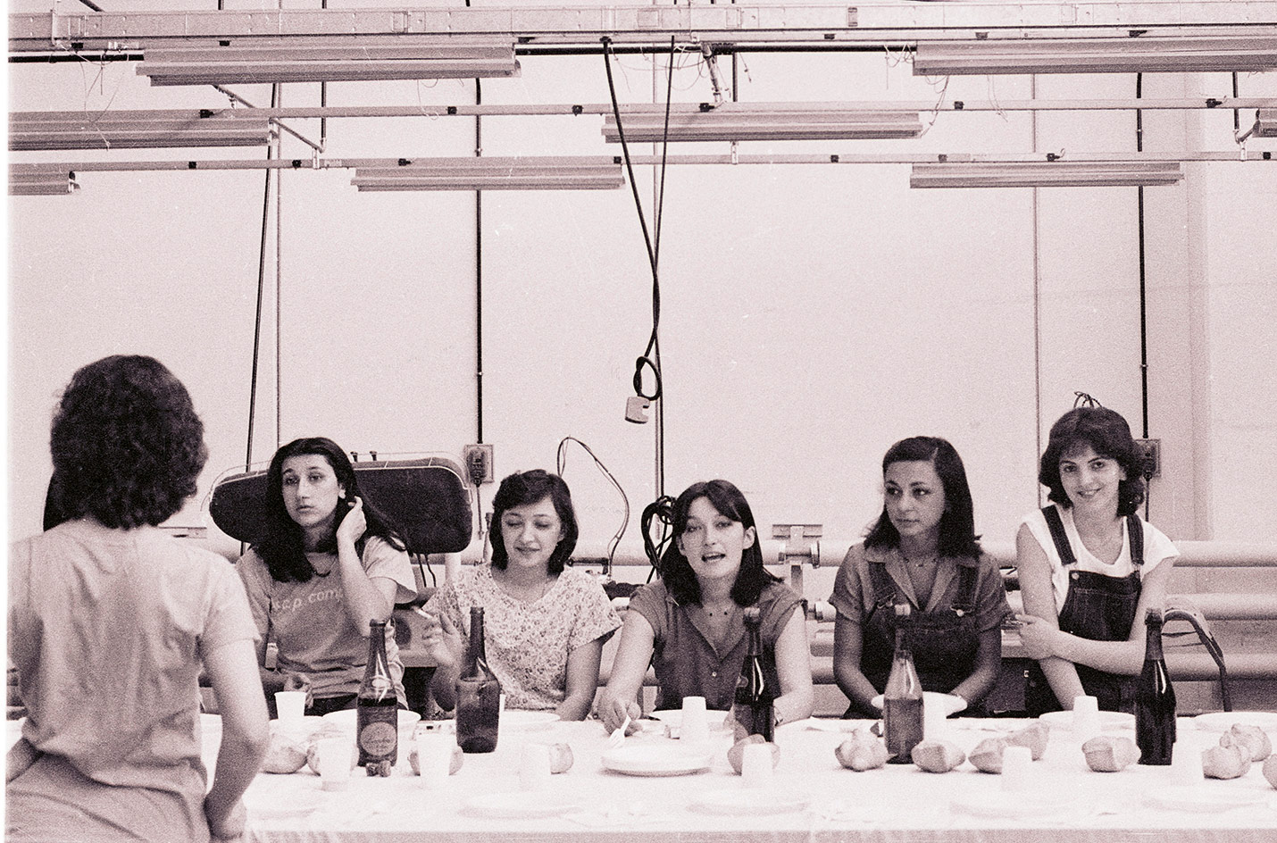 Photograph of female workers sitting in the CP Company factory
