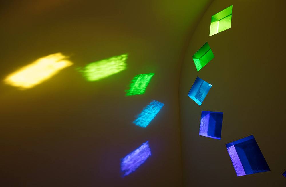 Dappled light comes through the coloured glass windows of Ellsworth Kelly's Austin atheist chapel