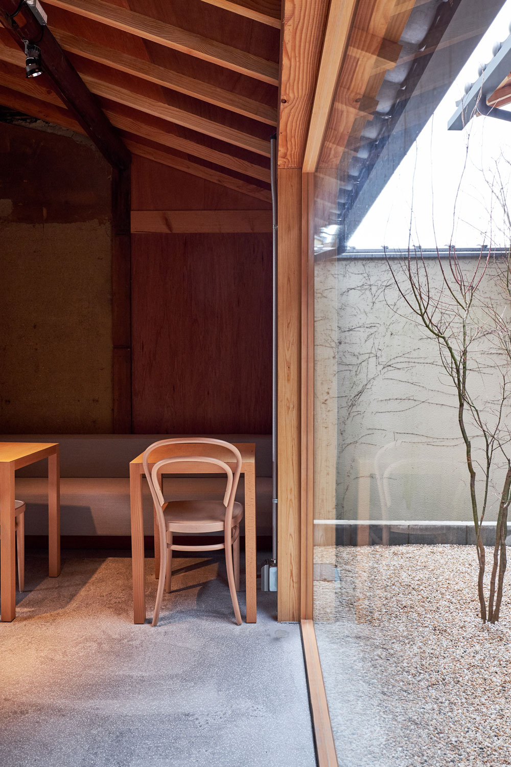 Interior view of the architectural zen Blue Bottle Coffee in Kyoto, Japan