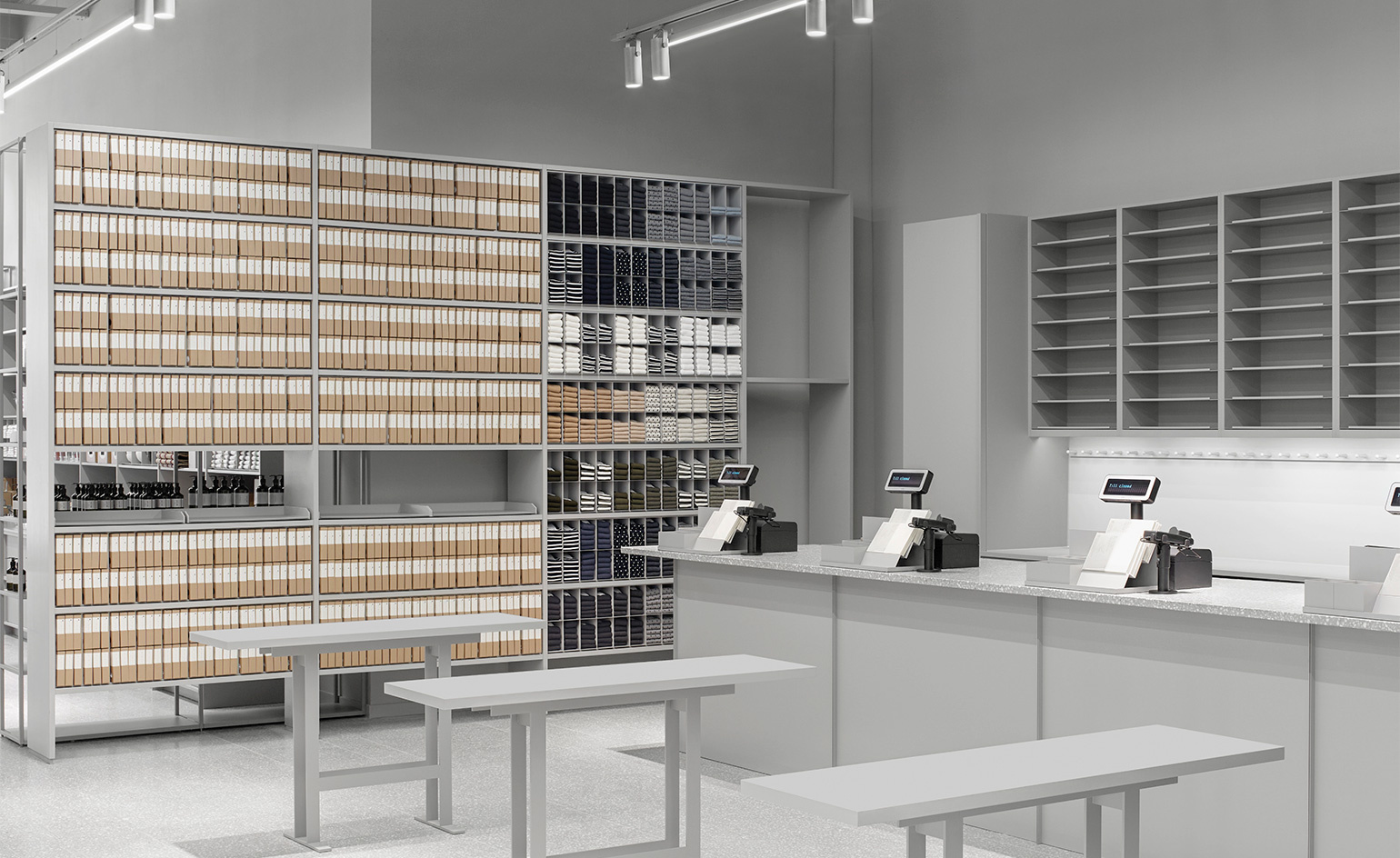 0e9e4f10831 At the Arket store, products are displayed cross cool grey shelves and  rails made up of simple repeating grids and vertical and horizontal planks.  '