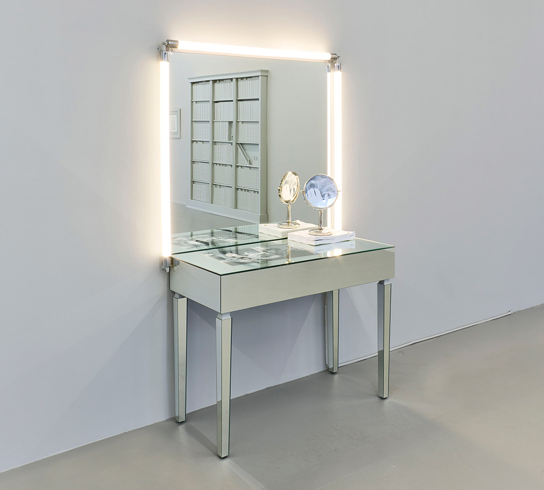 Vanity, 2017, by Barbara Bloom, vanity mirror and lighting, mirrored vanity table, photograph etched small vanity mirror, digital archival photograph, and movie scripts