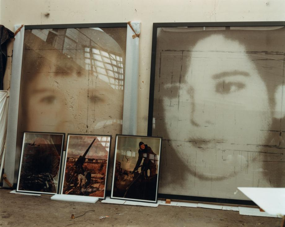 In Boltanski's studio, large prints on veil from his Après series, alongside three small lenticular prints from his Signal series