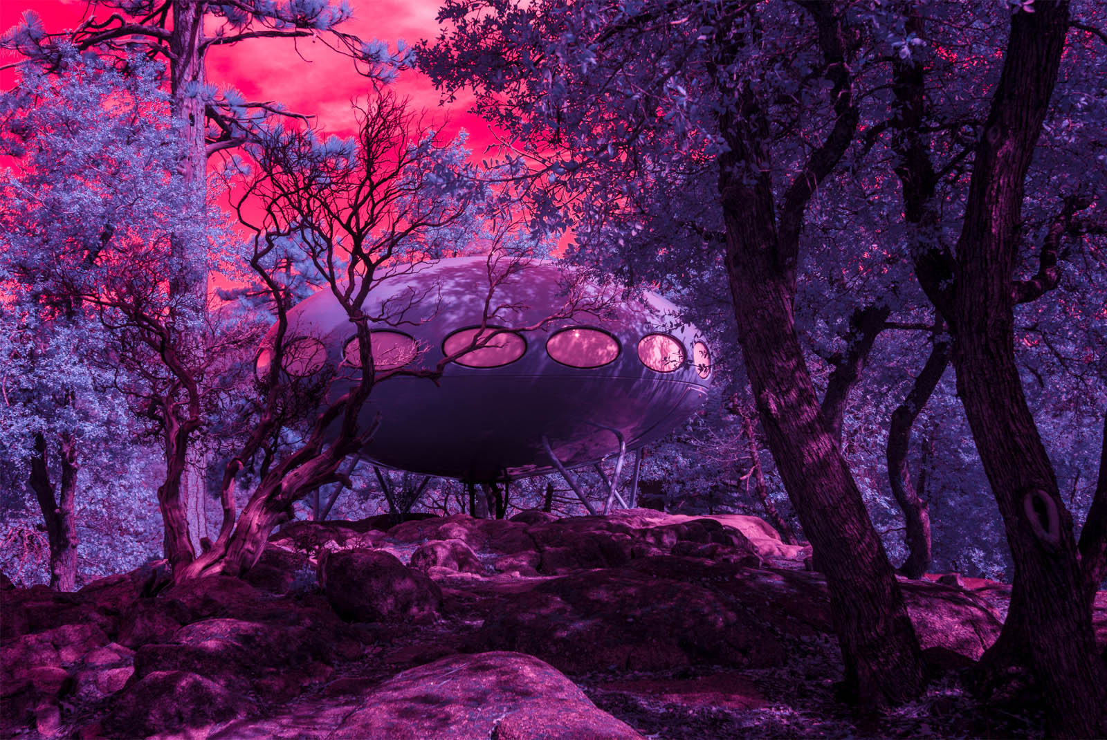 Infrared photograph of a spaceship=like Futuro House in the forest near Idyllwild