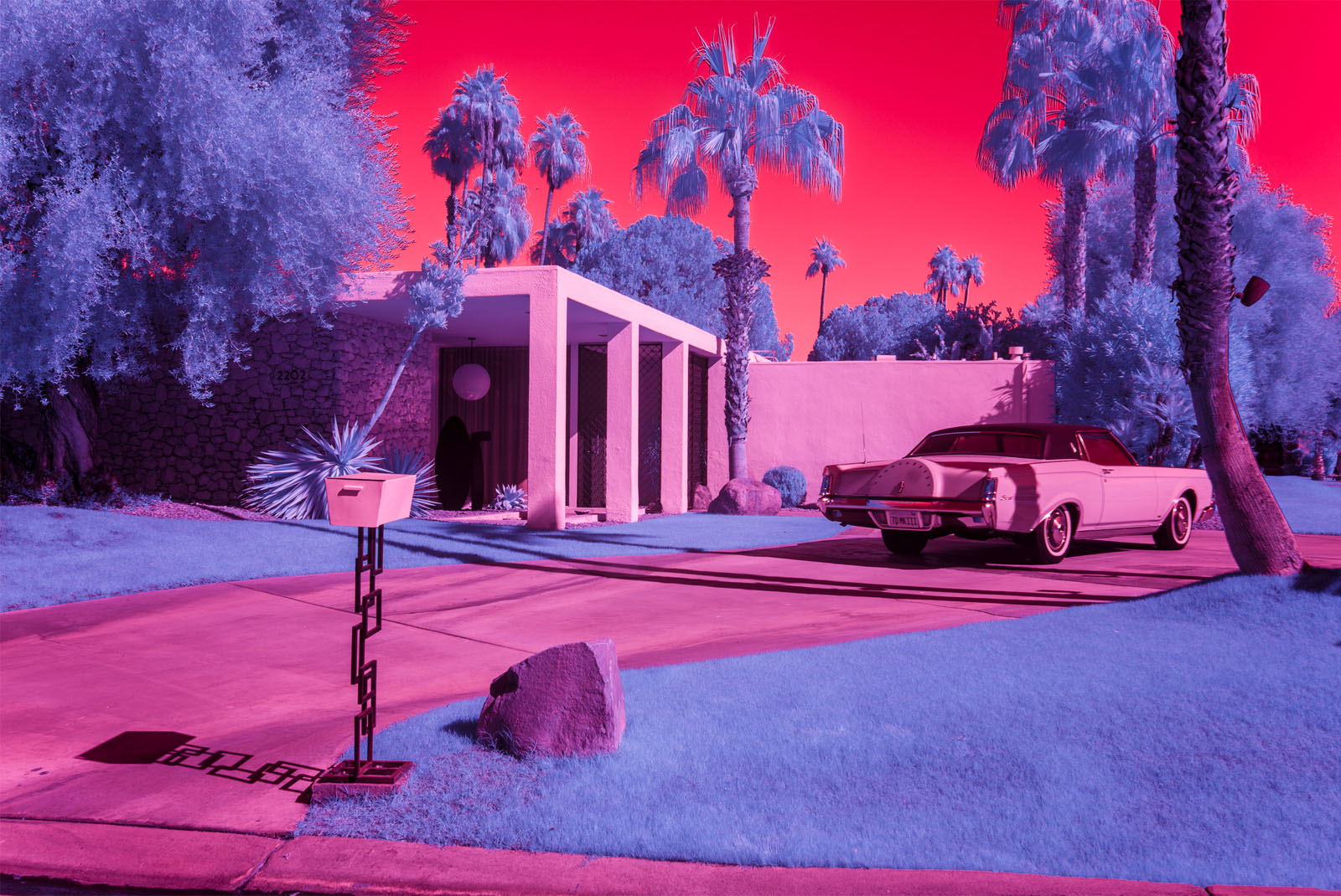 Infrared image of a classic Lincoln car in the driveway of a Palm Springs residence