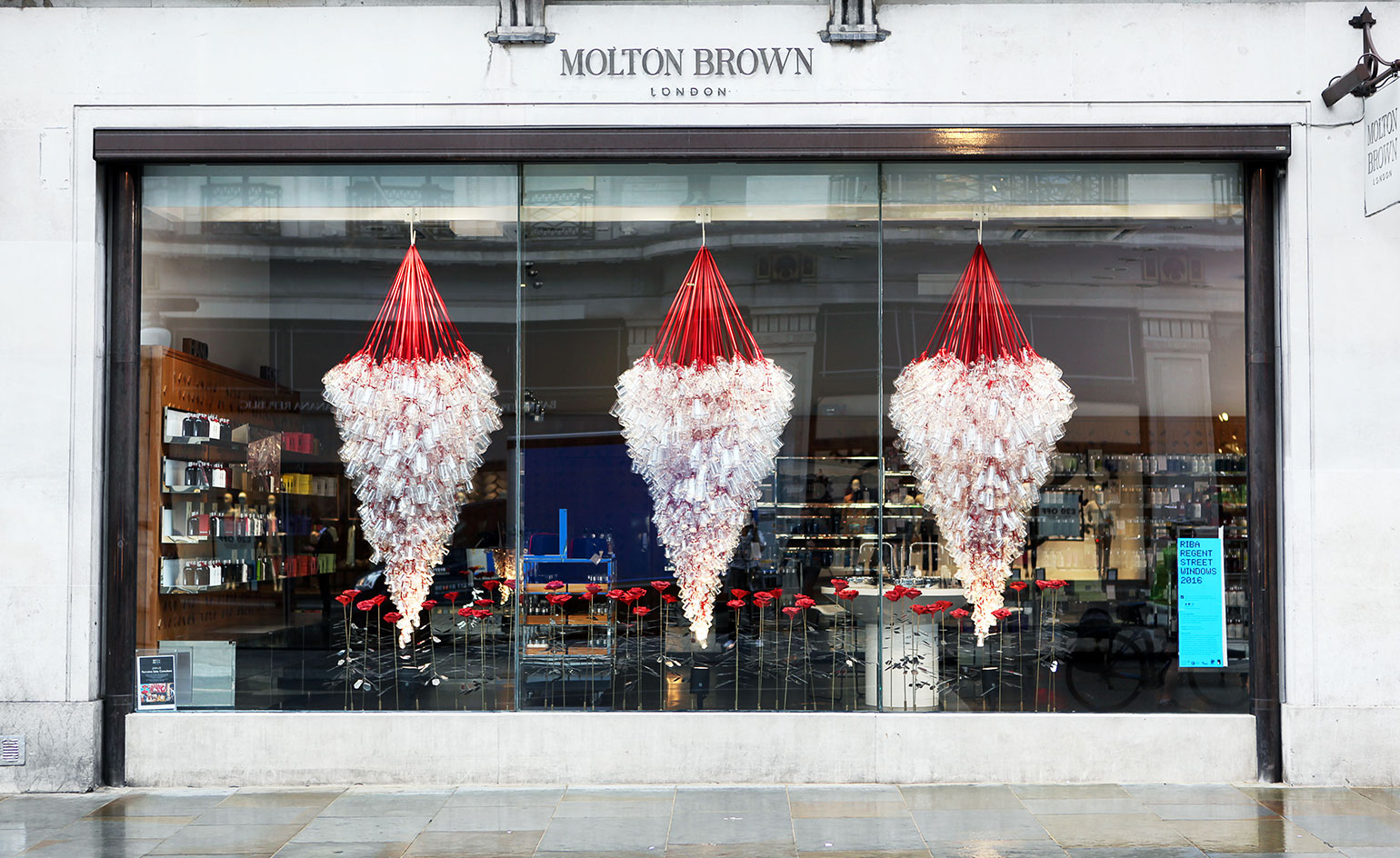 Metal roses and packaging bottles makeup this beautiful festive window decoration