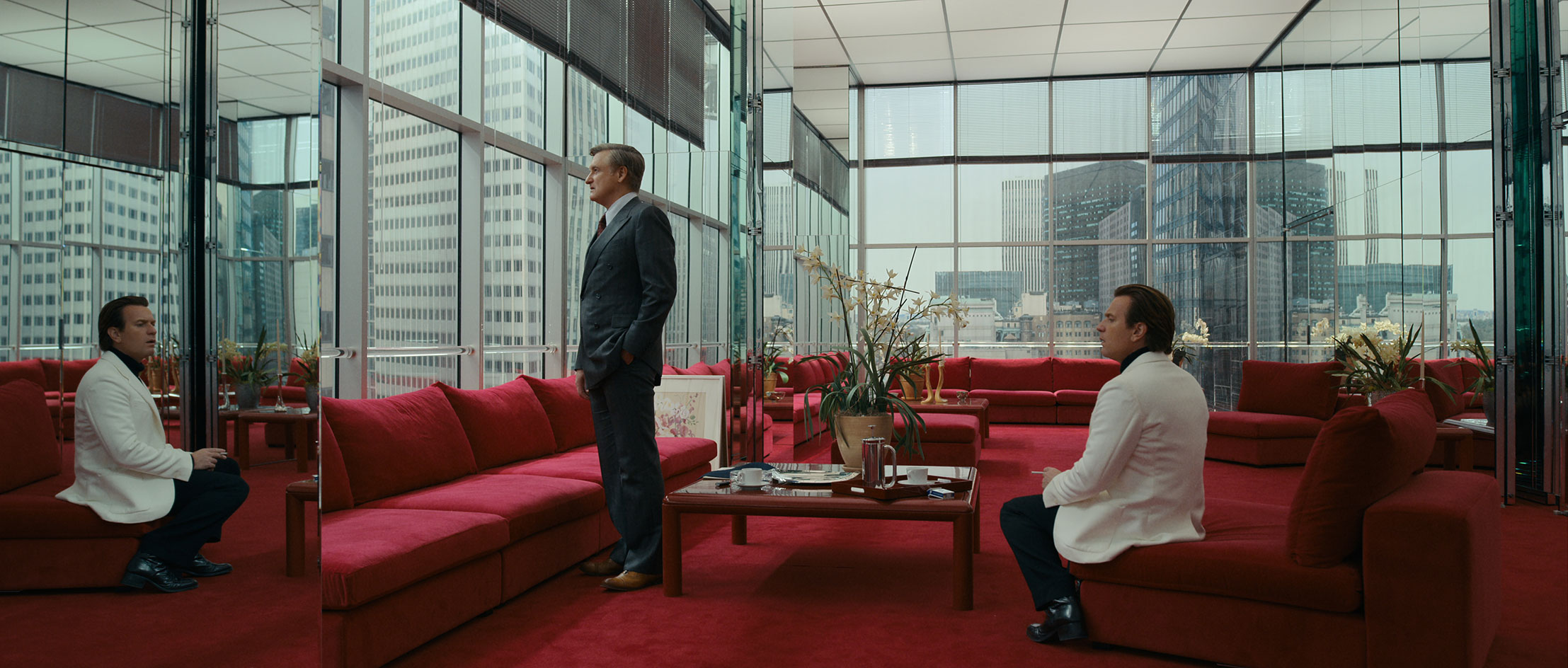 Netflix's Halston production still of Halston in his Olympic Tower office