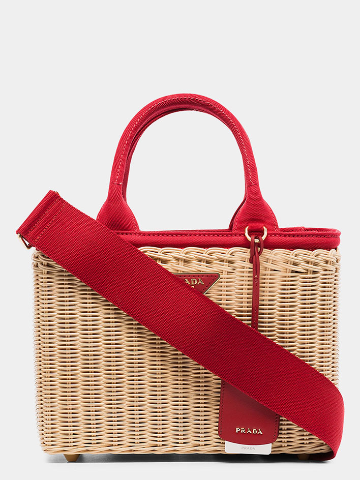Basket bags with red strap accents by Prada