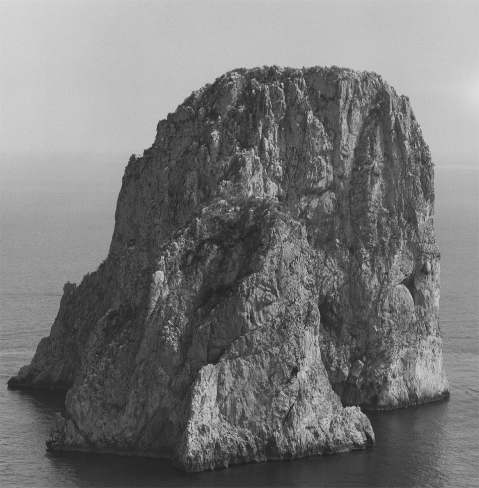 Gelatin silver print of a mountain surrounded by sea by Robert Mapplethorpe