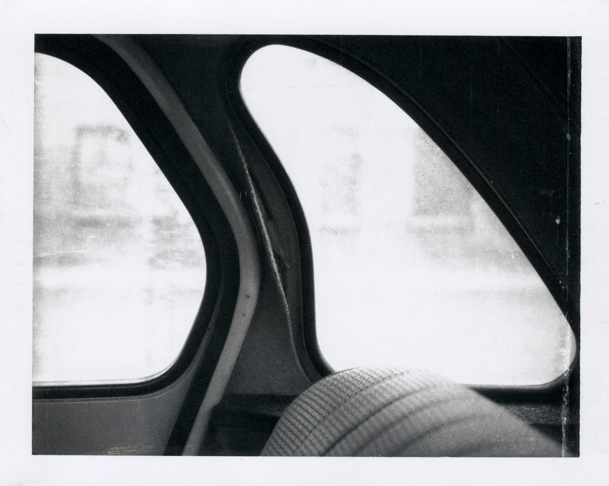 Detail of a black and white Polaroid by Robert Mapplethorpe of a car window in sunlight