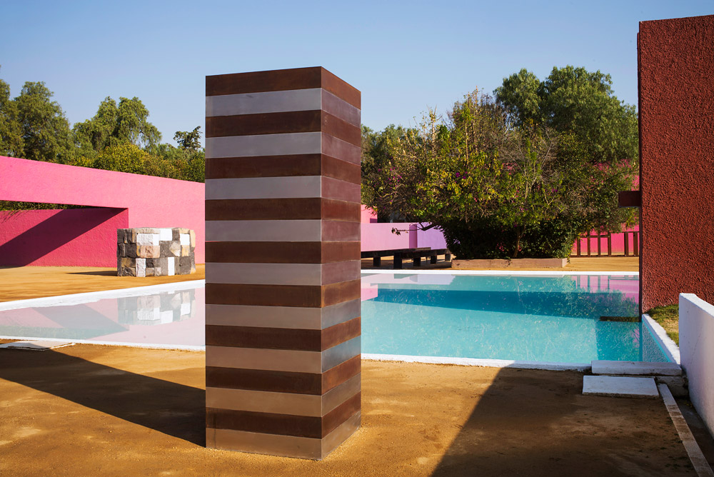 Installation view of Sean Scully's sculptures around the pool at the San Cristóbal estate