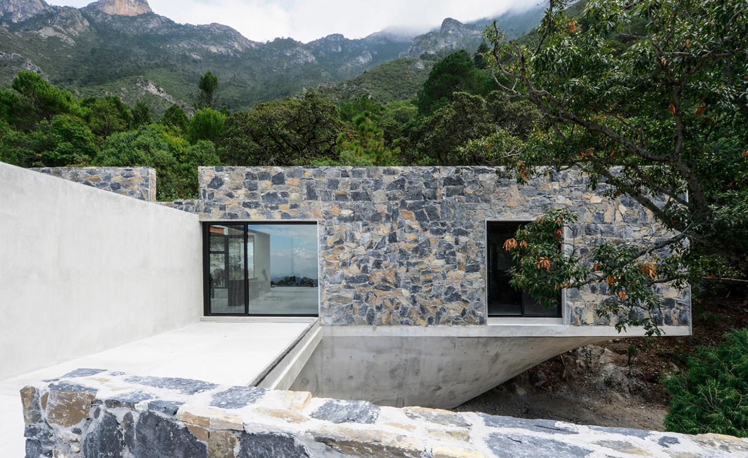 Concrete and stone layer into the landscape at Casa Bedolla in Mexico