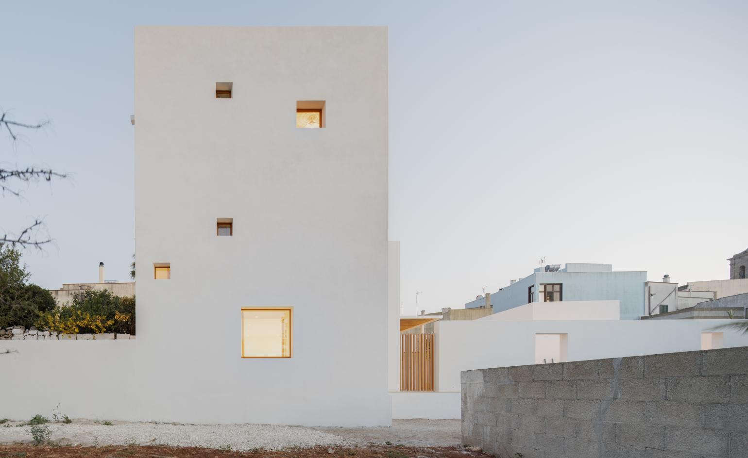 A cubist white house takes a modern approach to local architecture in southern Italy