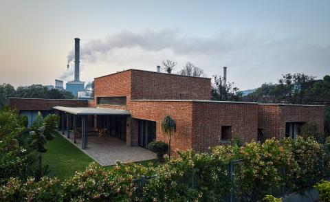 Exterior of Rajiv Saini's Dhampur House with factory in the background