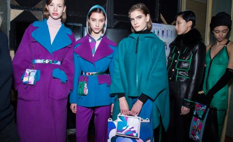 Models wear colour block wool coats in purple and blue, another wears a turquoise parka