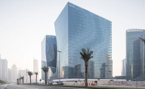 Opus Dubai by ZHA places a free-form void into the heart of an abstract cube