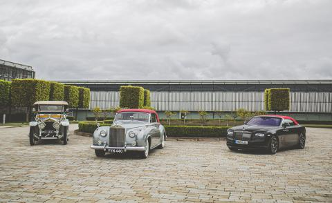 Three generations Rolls-Royce convertibles are parked on a driveway