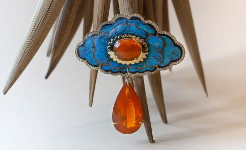 Silvia Furmanovich's blue brooch with red drop down gem