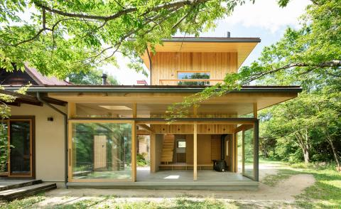A timber house in a Japanese forest brings a couple closer to their family