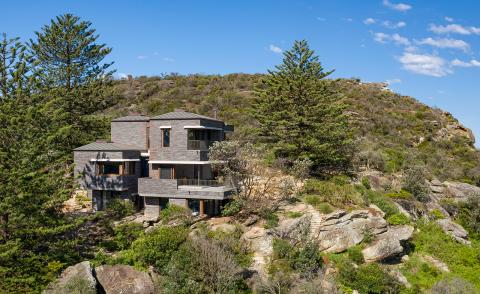 Casey Brown designs a rugged holiday house overlooking Avalon Beach in Australia