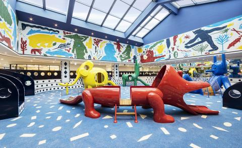 View of MOKA playground by Jaime Hayon featuring sausage dog slide