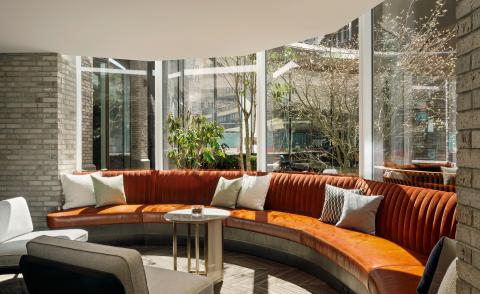 interiors view of orange sofa in The Lantern in New York
