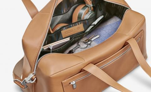 The collection's 'Everywhere Bag' in leather, and MW65 Active Noise-Cancelling wireless headphones