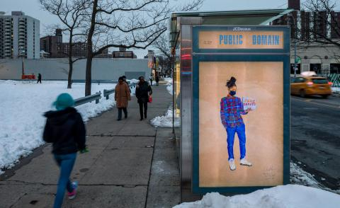 """Installation view of Aya Brown's portrait """"MIKEY"""" FIRE LIFE SAFETY ACCOUNT MANAGER, part of her COVID-19, 2020 series installed at a Brooklyn bus stop"""