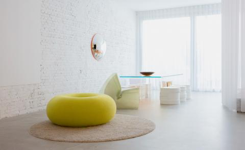 The yellow donut shaped pouf designed by Sabine Marcelis for Hem photographed at Sabine Marcelis' house