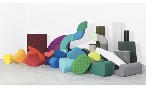 A stack of upholstered abstract shapes show the chromatic variety of Kvadrat's textiles