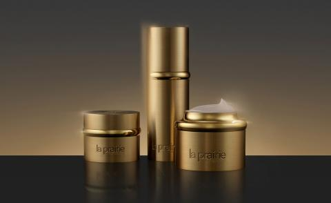 Still life image of La Prairie gold collection bottles
