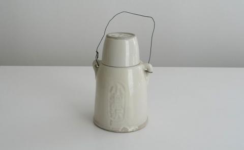 White jug against a grey background