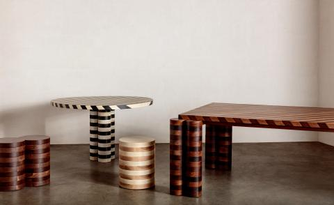 Striped dining and side tables, part of Kelly Wearstler's furniture collection 'Trascendence' and made of angle-cut hardwood