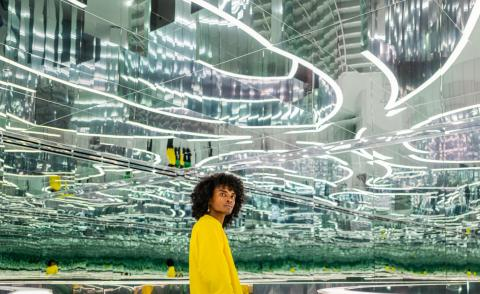 Person standing in a hall of mirrors