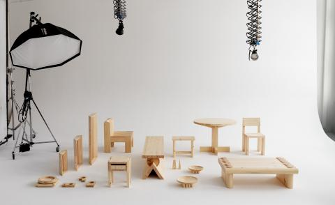 Wooden furniture pieces by Finnish design brand Vaarnii arranged on a white background in a photo studio