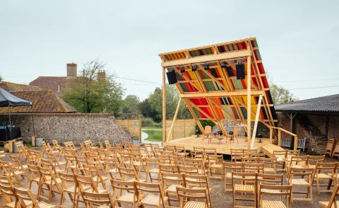 colourful Charleston outdoor stage with seating arrangement