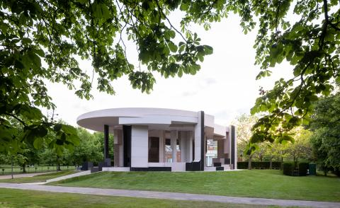 the serpentine pavilion by counter space, built, in its green setting in Kensington Gardens