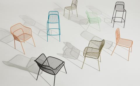 Eight chairs showing the range of garden furniture designed by Benjamin Hubert in pink, blue, green, mint and black