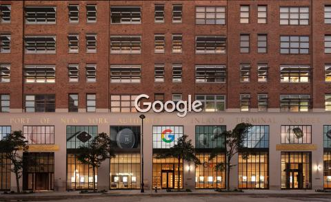 The façade of the Google New York store, featuring a brick facade and high windows facing the street. Google's logo is visible above the door