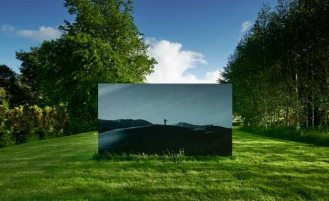 Katie Paterson,Inside this desert liethe tiniest grain of sand (2010).Photograph presented on a billboard © Katie Paterson