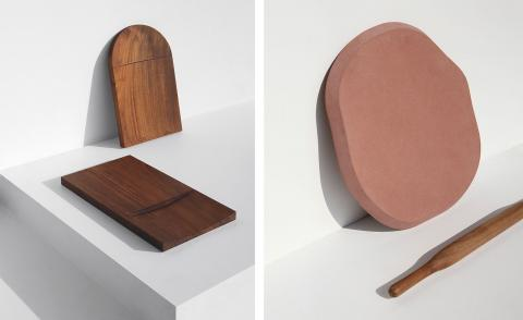 Left, two chopping boards in reclaimed teak. Right, an asymmetrically shaped rolling board for making roti bread, made of red agra sandstone and a wooden rolling pin