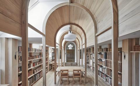Contemporary library with dramatic arches by Crawshaw Architects