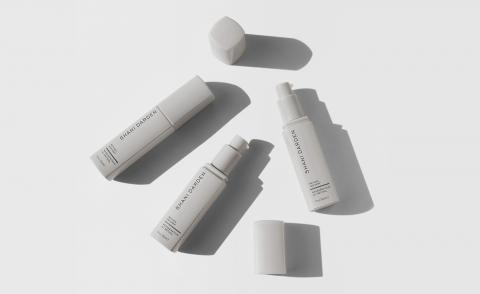 Los Angeles facialist and retinol expert Shani Darden's skincare range, grey bottles against a grey background