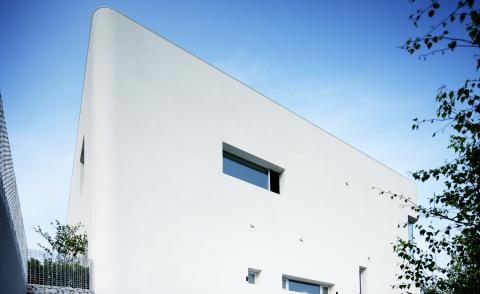 rounded house in South Korea is a white boxy composition with curved corners