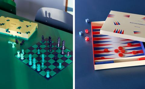 Left, shown on a green table, Hay Play chess set with chess board in blue and green, and pieces in matching colours. Right, on a blue table is the backgammon set inside a box with white, blue and red board and pieces in blue and red