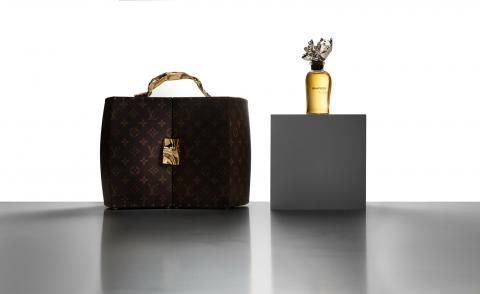 Louis Vuitton perfume with bottle and carrier trunk designed by Frank Gehry