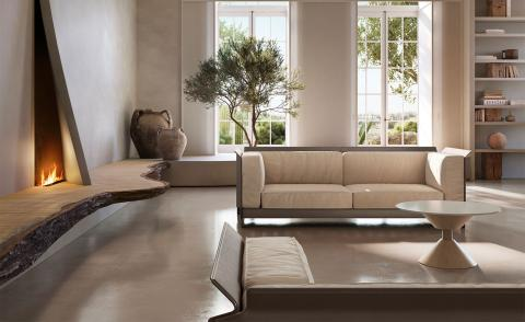 Apulo sofa by Formafantasma by Natuzzi, featuring a rectangular rigid shell with cream coloured upholstered seat and back, shown in a light filled living room